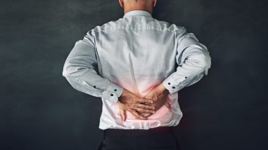 Male patient with lower back pain