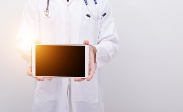 Doctor holding iPad, technology, social media