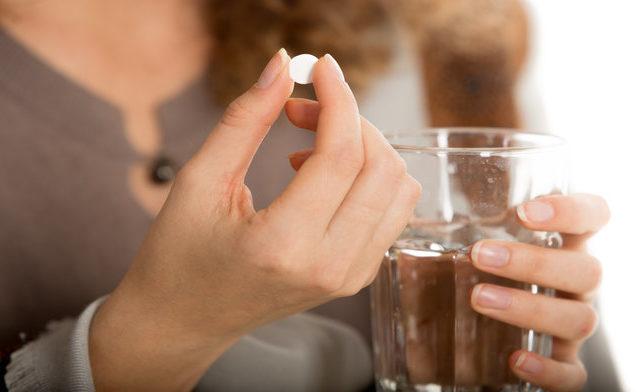 woman-taking-a-pill_1115