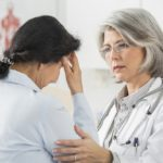 Patient visiting doctor with migraine