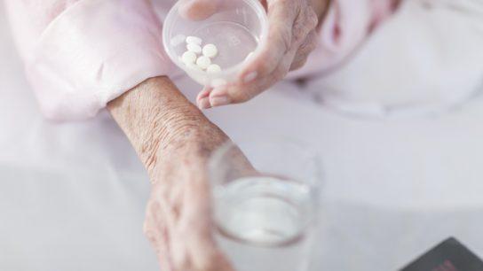 Elderly woman taking medication