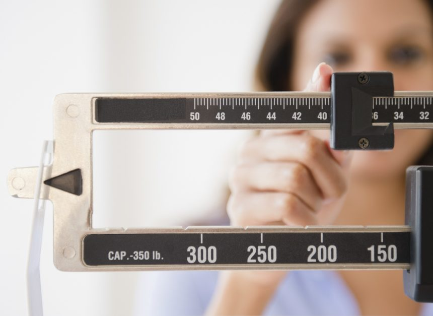 woman being weighed, weight, scale