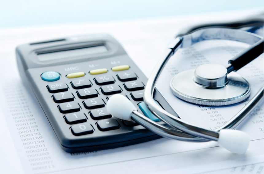 calculator, stethoscope, healthcare costs