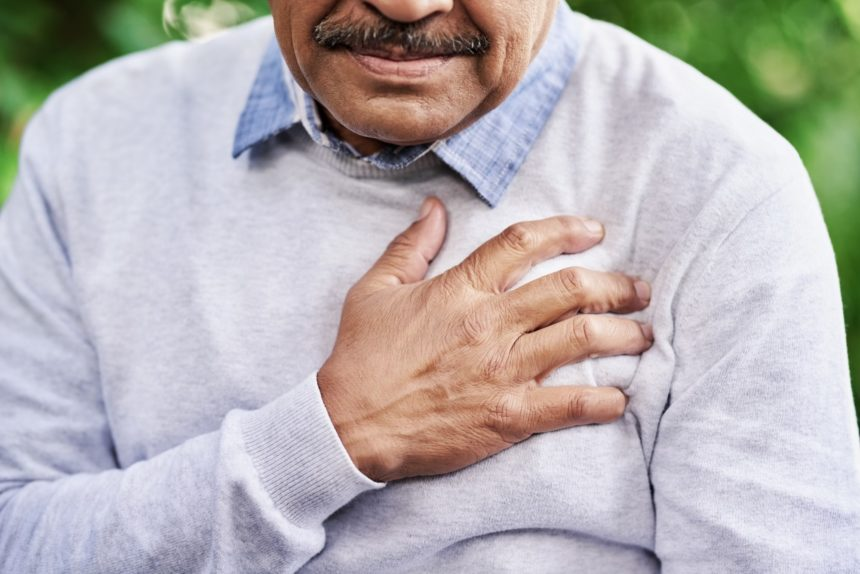An African American man has chest pain.