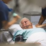 Patient in hospital bed. Critical care needed.