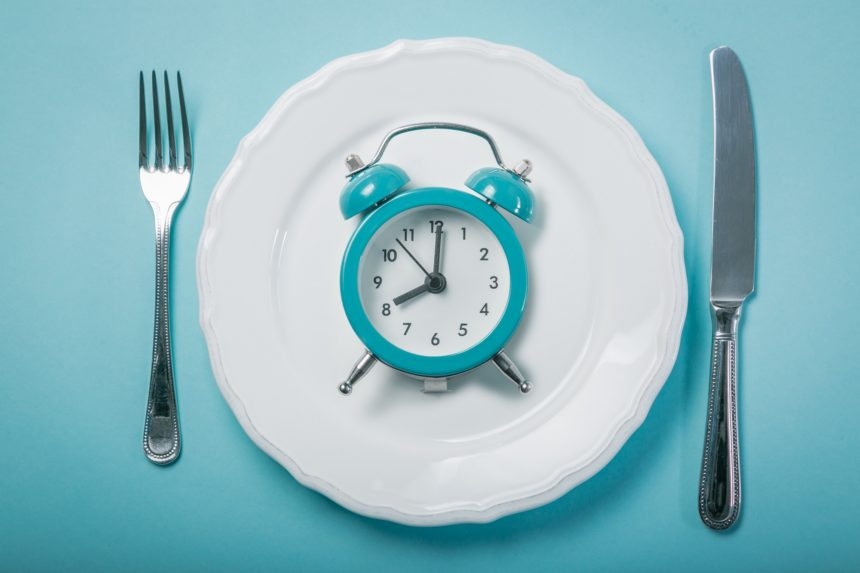 alarm clock and dinner plate