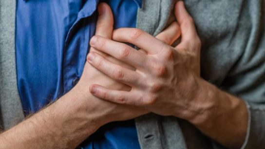 Person clutching their chest in pain