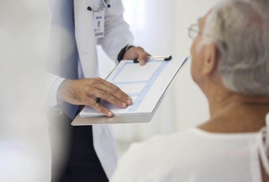 doctor showing medical chart to patient
