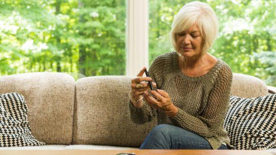 diabetic woman testing glucose